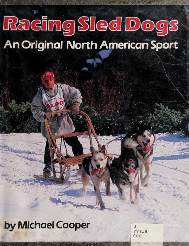 Racing sled dogs by Michael L. Cooper